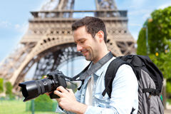 Young attractive tourist taking pictures in Paris Stock Photography