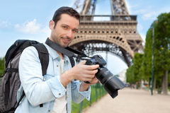 Young attractive tourist taking pictures in Paris Royalty Free Stock Photo