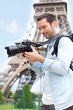 Young attractive tourist taking pictures in Paris Stock Photos