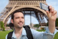 Young attractive tourist taking selfie in Paris Royalty Free Stock Images