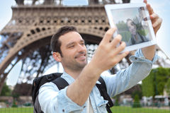 Young attractive tourist taking selfie in Paris Stock Photos