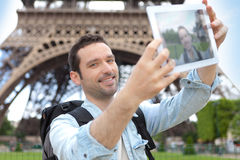 Young attractive tourist taking selfie in Paris Stock Photography