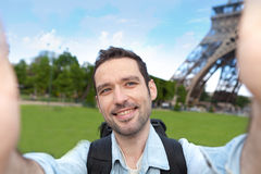 Young attractive tourist taking selfie in Paris Royalty Free Stock Image