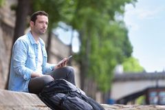 Young attractive tourist using tablet in Paris Stock Photos