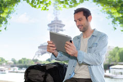 Young attractive tourist using tablet in Paris Royalty Free Stock Photo