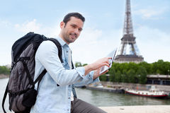 Young attractive tourist using tablet in Paris Stock Image