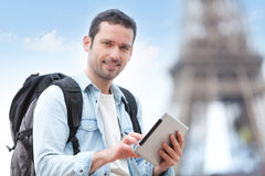 Young attractive tourist using tablet in Paris Royalty Free Stock Images