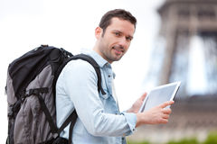 Young attractive tourist using tablet in Paris Stock Photography