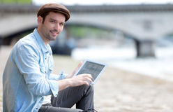 Young attractive tourist using tablet in Paris Royalty Free Stock Photography