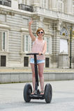 Young attractive tourist woman in shorts city tour riding happy electrical segway in Spain Stock Image