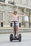 Young attractive tourist woman in shorts city tour riding happy electrical segway in Spain Royalty Free Stock Photo