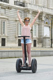 Young attractive tourist woman in shorts city tour riding happy electrical segway in Spain Stock Images