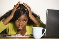 Young attractive unhappy and exhausted black African American woman working lazy on Monday at office computer desk feeling overwhe. Lmed bored and frustrated in royalty free stock image