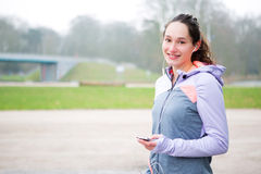 Young attractive woman adjust her music player before running Stock Photography