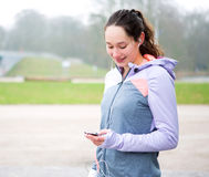 Young attractive woman adjust her music player before running Royalty Free Stock Photos