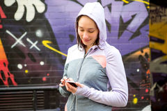Young attractive woman adjust her music player before running Royalty Free Stock Photography