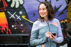 Young attractive woman adjust her music player before running Royalty Free Stock Images