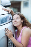 Young attractive woman adoring her new car Stock Photography