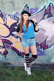 Young Attractive Woman against Graffiti Royalty Free Stock Photo