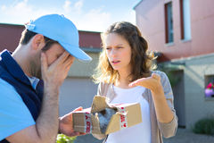 Young attractive woman angry against delivery man Stock Image