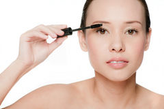 Young and attractive woman applying mascara Royalty Free Stock Photo