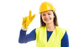 Young woman architect showing peace sign royalty free stock images