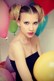Young attractive woman and baloons Stock Photography