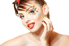 Young attractive woman with beautiful art cube abstract make-up Stock Image