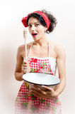 Young attractive woman beautiful pinup girl holding bowl and wooden spoon happy smiling & looking at camera Royalty Free Stock Photo