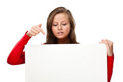 Young attractive woman behind empty board on white background Royalty Free Stock Photos