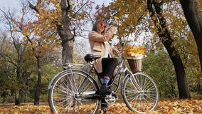 Young female with bicycle stock footage