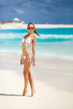 The young attractive woman in bikini on a beach Royalty Free Stock Image