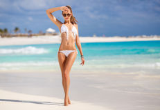 The young attractive woman in bikini on a beach Stock Images