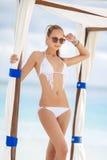 The young attractive woman in bikini on a beach Stock Photo
