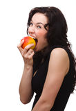 Young attractive woman is biting an apple Stock Image