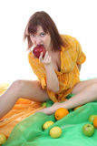 Young attractive woman biting red apple Stock Images