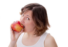 Young attractive woman is biting red apple Stock Image
