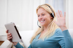 Young attractive woman blonde chatting on tablet Royalty Free Stock Images