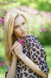 Young attractive woman in blooming spring trees Stock Photos