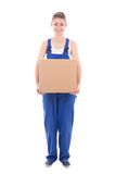 Young attractive woman in blue coveralls with cardboard box isol Royalty Free Stock Photos