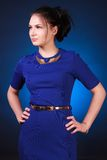 Young attractive woman in a blue evening dress Royalty Free Stock Photos