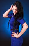 Young attractive woman in a blue evening dress Stock Images