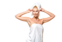Young attractive woman with blue eyes in a towel Stock Photo