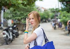 Young attractive woman with blue handbag. On street royalty free stock images