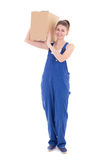 Young attractive woman in blue workwear with cardboard box isola Royalty Free Stock Image