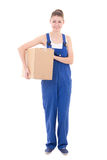 Young attractive woman in blue workwear holding cardboard box is Royalty Free Stock Image