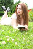 A young attractive woman with a book Royalty Free Stock Photography