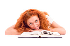 Young attractive woman with the book lying Royalty Free Stock Image