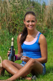Young attractive woman and bottle of champagne Royalty Free Stock Image