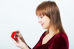 Young attractive woman with a box for rings Royalty Free Stock Photography